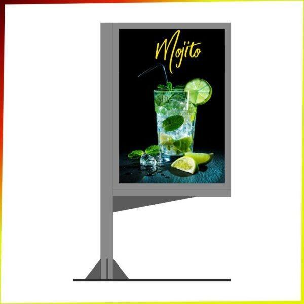 Zdjęcie przedstawiające citylight COCO. Citylight w szarym kolorze, z podstawą po lewej stronie ukazujący plakat drinku mojito.