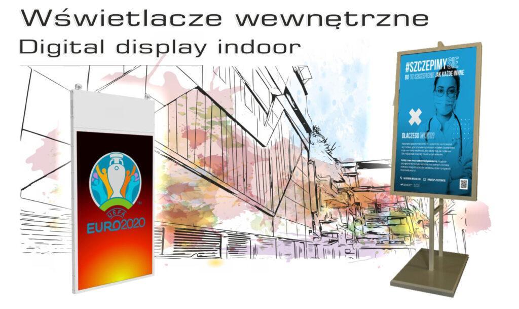Grafika w pastelowych kolorach przedstawiająca budynek, na tle którego widać dwa wyświetlacze wewnętrzne